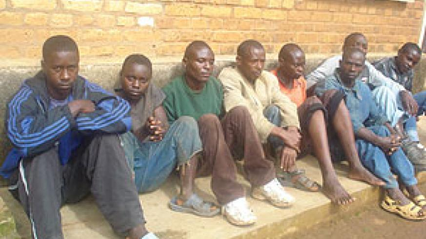 A group of suspects held at Nyamabuye station for questioning over the death of Maria Mukeshimana. (Photo/ D.Sabiiti)