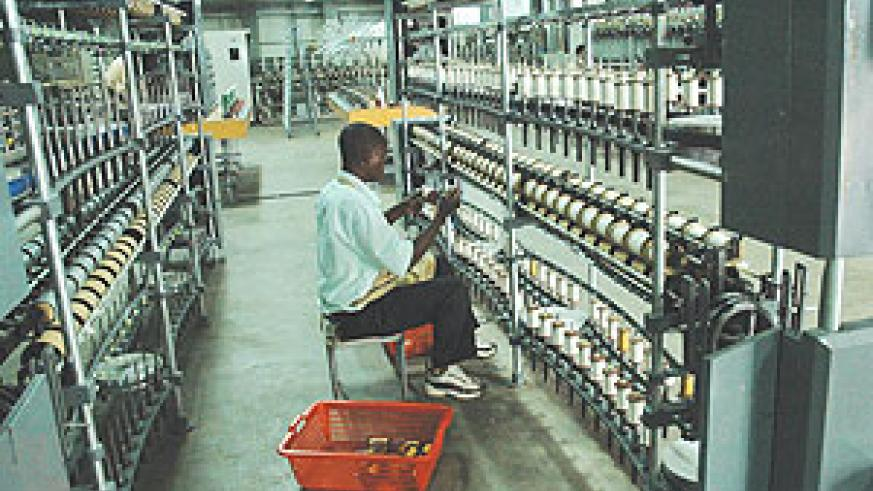A UTEXRWA employee, working on a silk production line. (FIle Photo)