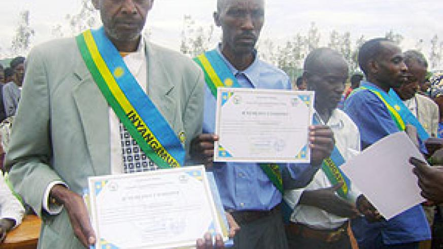 Gacaca judges display certificates of merit awarded to them. (Photo: C. Nyiramatama)
