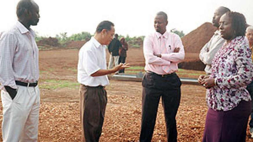 Gashlan Ahmad, the Project Manager  explaining to the Rwanda Free Trade company chairman Jack Kayonga. (Photo/ F.Goodman)