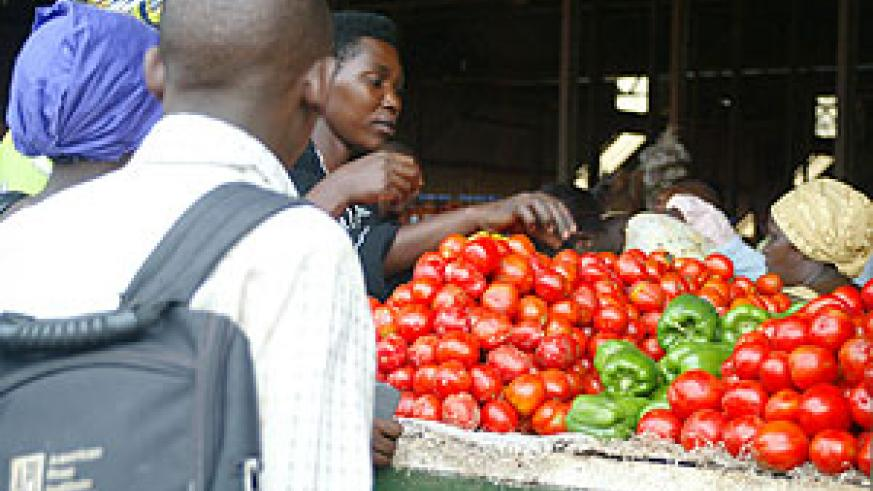 Traders selling tomatoes in Kimironko market.