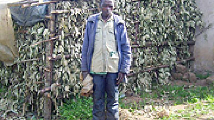 One of the poor beneficiaries Paul Nsabimana stands before the shed he constructed for the cow he was directed to return to the original owner. (Photo: A. Gahene)