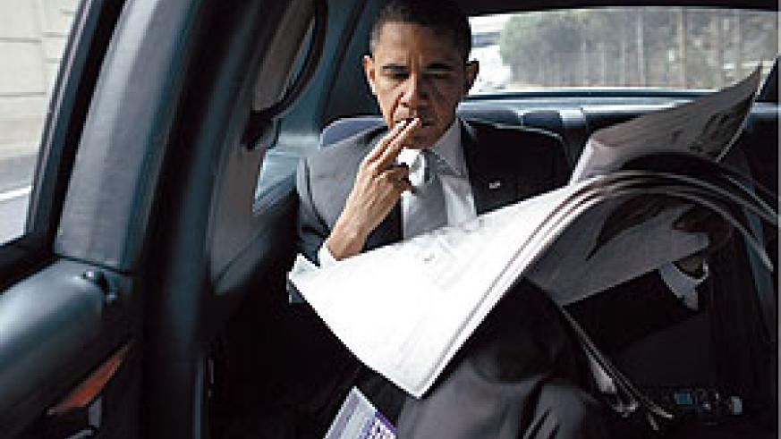 The president scans the headlines on his way back to the White House.