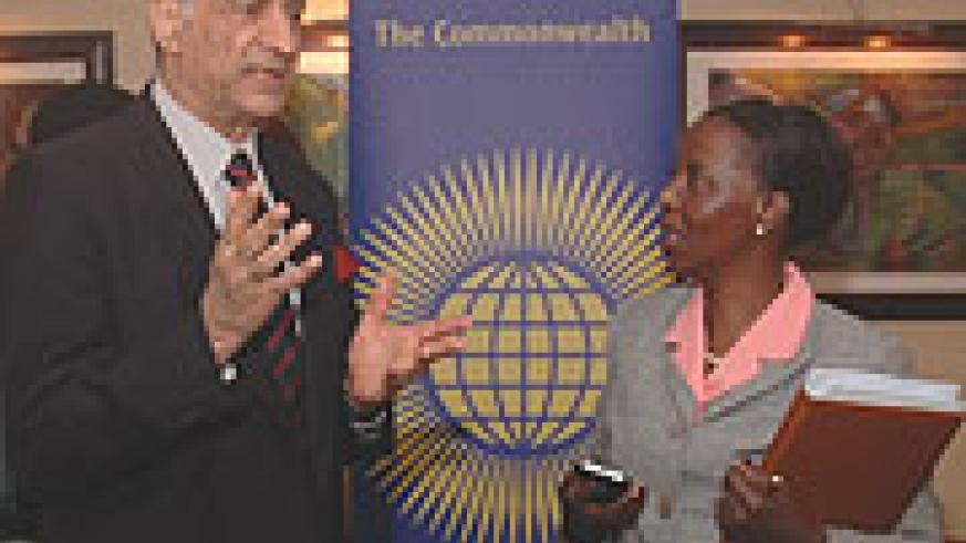 Commonwealth SG, Kamalesh Sharma with Foreign Affairs Minister, Louise Mushikiwabo before meeting the press yesterday at Serena Hotel. (Photo/F. Goodman)