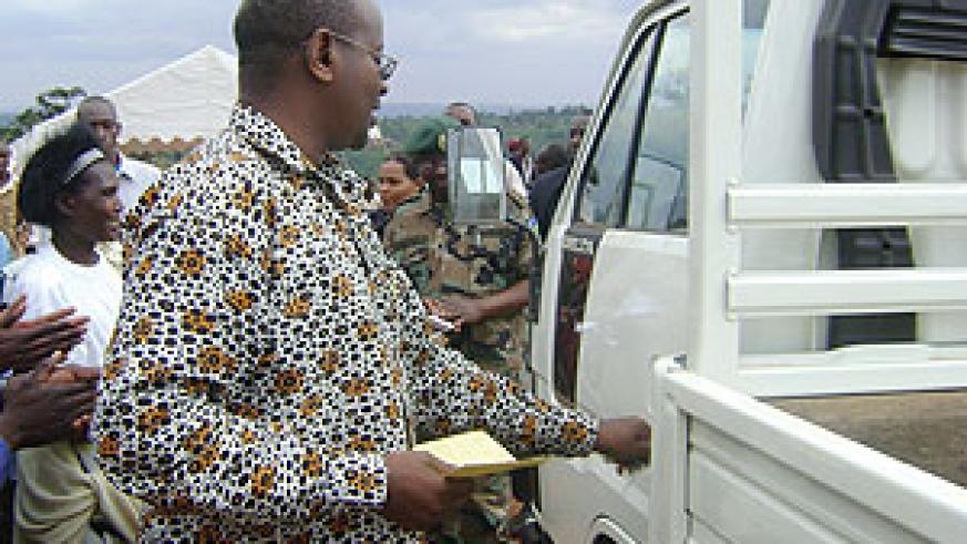 HERE YOU ARE:  Minister James delivering the truck to KOPANA yesterday. (Photo/ F.Kanyesigye)