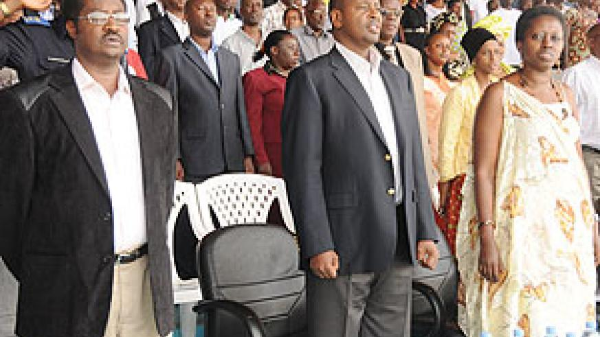 Local Government Minister James Musoni (Middle) leads KCC Local Leaders through the National Anthem shortly before the meeting started. Right is City Mayor Aisa Kirabo Kacyira. (Photo/F.Goodman)