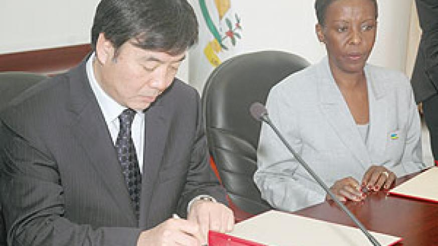Chinese Vice Minister of Foreign Affairs  in Charge of Africa, Zhai Jun ,(L) and Rwanda's Louise Mushikiwabo during the signing ceremony Yesterday. (Photo J Mbanda)