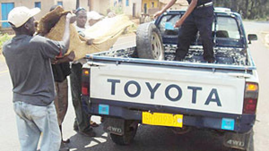 Residents help to load the body of the deceased on a police pickup. (Photo: S. Nkurunziza)