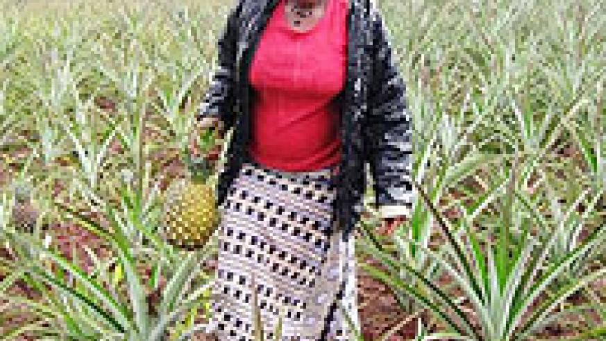 Through income generated from CRS and basket weaving, Françoise managed to buy an acre of land on which she planted pineapples.