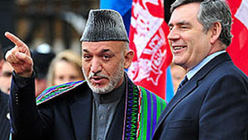 Afghan President Hamid Karzai, left, and Britain's Prime Minister Gordon Brown arrive at the London Conference on Afghanistan
