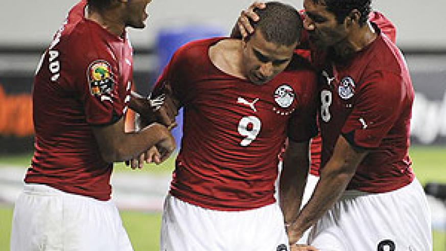 Mohamed Zidan of Egypt(CL) celebrates after scoring the second goal against Algeria during their semi final