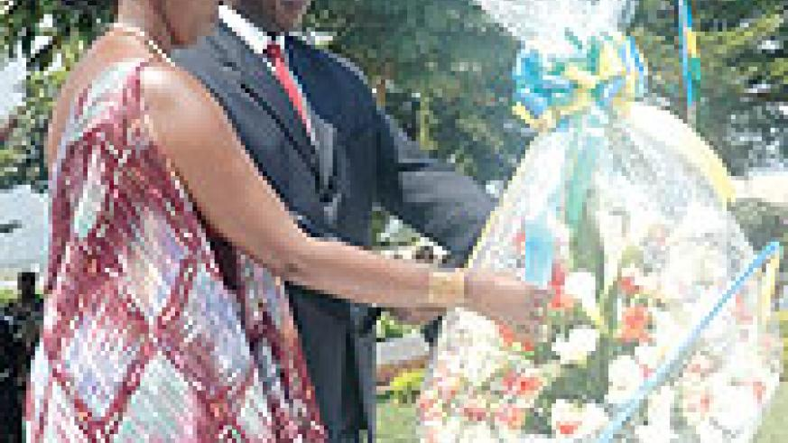 President of the Senate Vincent Biruta and his wife laying a wreath at the National  Heroes grounds Yesterday. (Photo J Mbanda)