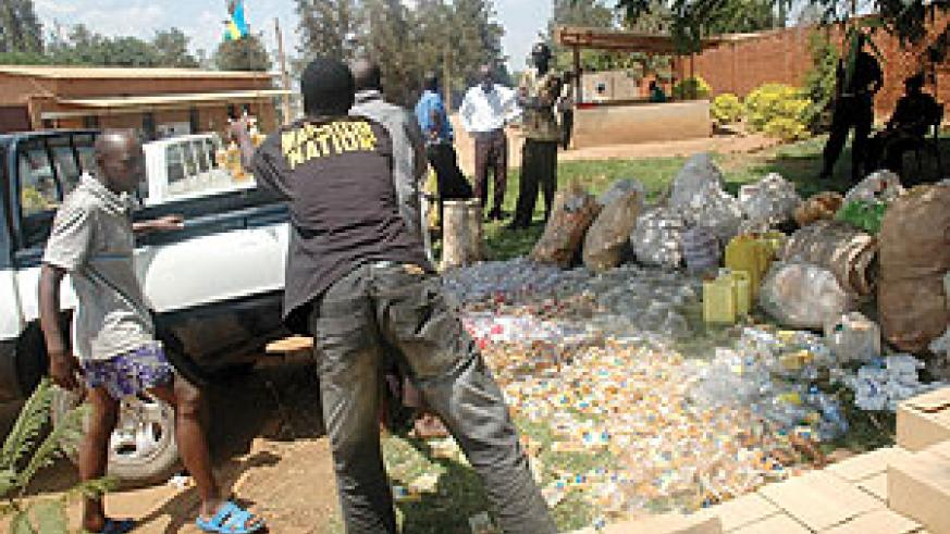 Illicit drugs and polythene bags being loaded on a Police pick-up truck car at Kicukiro Police Station before being destroyed yesterday. (Photo/ J. Mbanda)