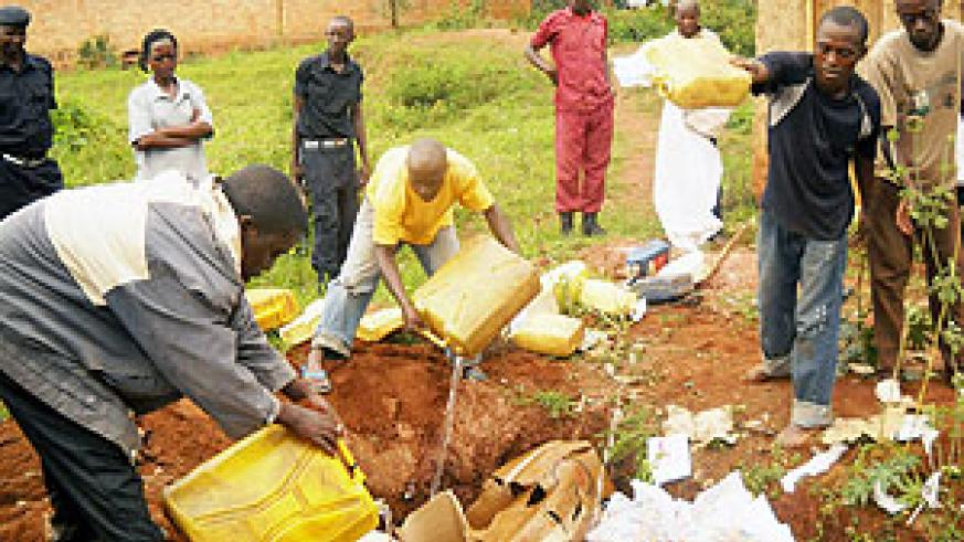 Kabarondo Police pouring Kanyanga that was recently impounded from traffickers. (File photo)