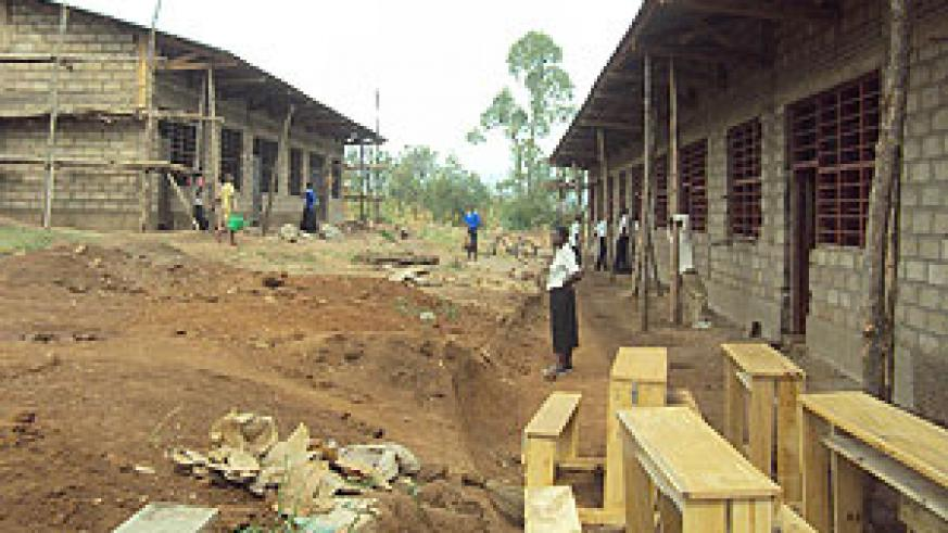 Students at Rurenge Secondary School helping to complete their classrooms.