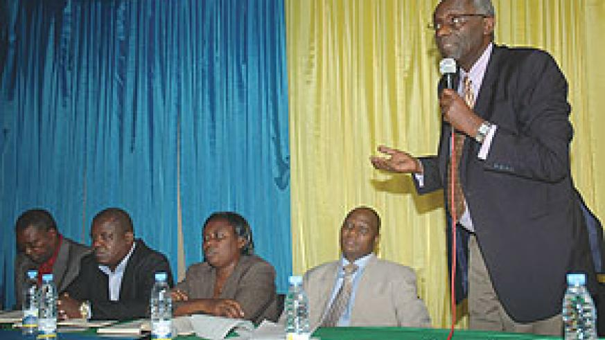 ISSUED CALENDAR: NEC Chairman Prof. Chrysologue Karangwa, NEC Executive Secretary Charles Munyaneza with some commissioners at a recent meeting. (File Photo)