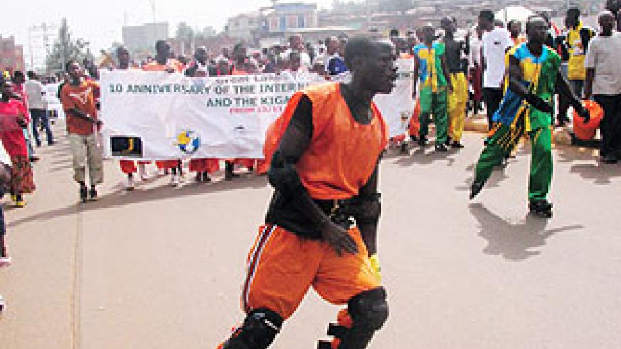 Great Lakes youth match through the city during the 10th celebration of the Kigali declaration (Photo. C. Kwizera)