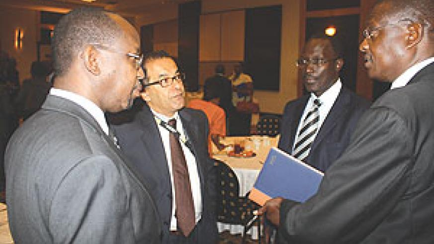 Gara (left) listens to Sam Nkusi of Altech Stream (right) while Khaled Mikkawi and Andrew Rugege both of MTN look on. (Photo/ D. K. Musoke)