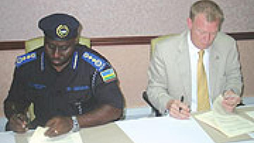 Commissioner General of Police Emmanuel Gasana and Canada's Richard Le Bars signing the MoU yesterday. (Photo/ F. Goodman)