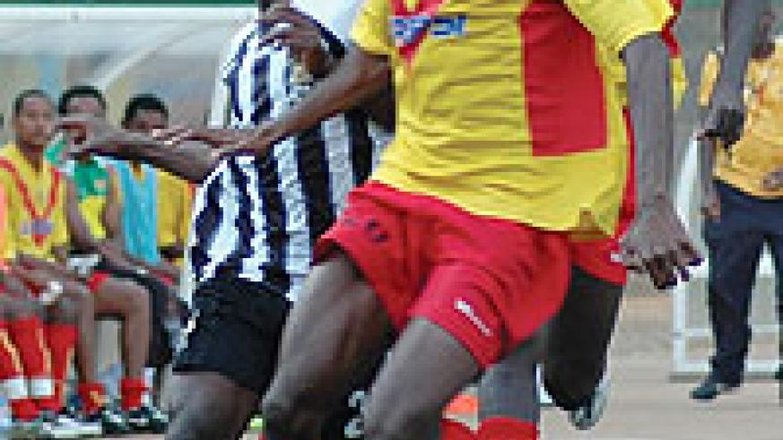 Kabange Twite (L) battles for the ball with St. George's defender