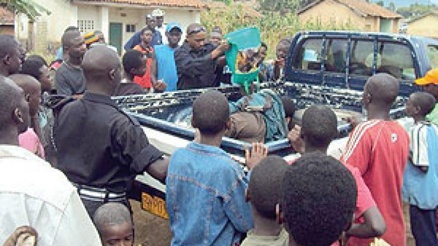 SURVIVES LYNCHING: The suspect thief behind a police pick-up truck. (Photo/ S. Nkurunziza)