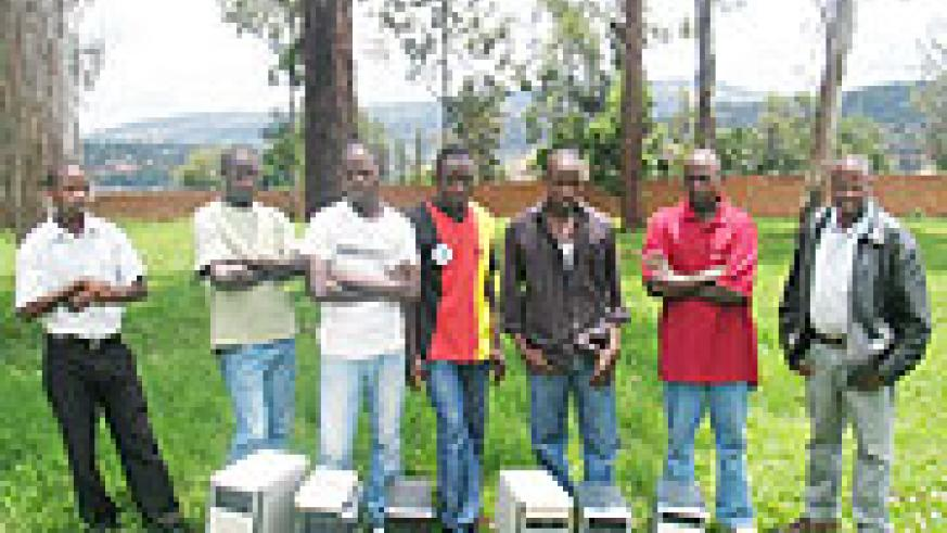The suspects paraded behind the equipment  they used in pirating music. Police hsd mounted a crackdown on piracy (Courtsey Photo)