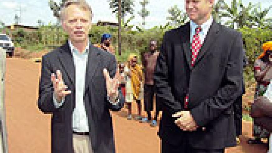 Dennis Wellar (L)Director  USAID Rwanda and Robert Rosengren (R) talkng to residents a long the newly rehabilated Ntunga-Rubona feeder road (Photo S Rwembeho)