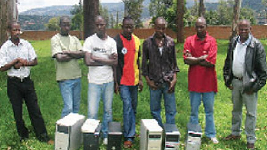 The suspects paraded behind the equipment  they used in pirating music. Police had mounted a crackdown on piracy. (File photo)