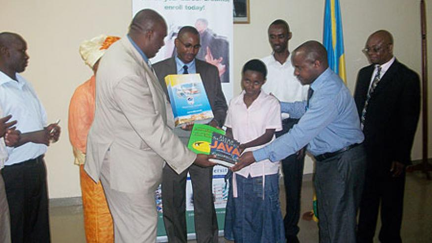 Simon Gicharu, Chairman and founder of Mt Kenya university awards text books to one of the best students(Photo/ G. Mugoya)