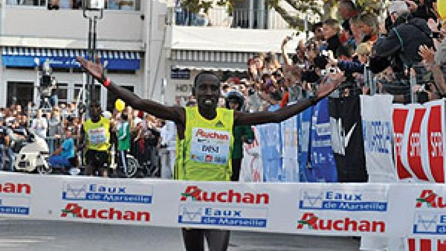 Dieudonne Disi celebrates after crossing the finish line first in a recent race in Marseille. (File photo)