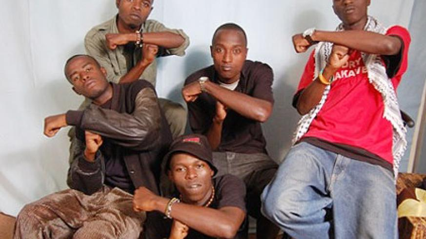 Tuff Gang, a local hip hop group that J. Polly (top left) belongs to, record with Day One Productions.(Net photo)