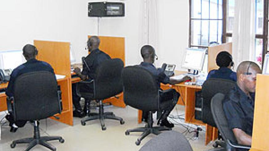 Officers recieving calls inside the Emergency Call Centre at the Police HQ in Kacyiru. (Photo/ I. Mugisha)
