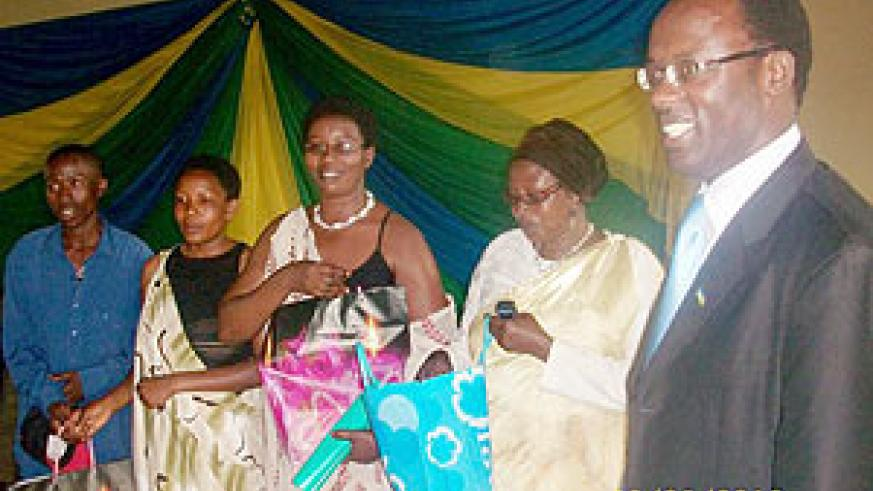 Governor Fidèle Ndayisaba presents awards to outstanding women in development. (Photo: D. Sabiiti)