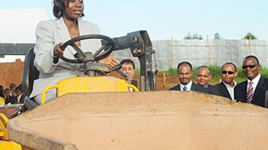 Commerce and Industry Minister Monique Nsanzabaganwa drives a tractor at the groundbreaking ceremony for Bakhresa Milling Project at the Industrial park yesterday. (Photo J Mbanda)