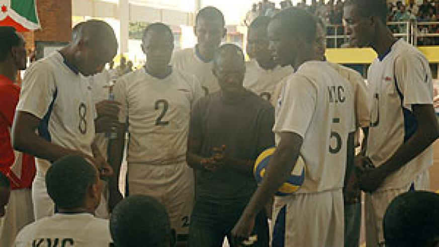 KVC players take tips from their coach Nsengiyumva during last year's Coupe du Rwanda competition. The team were losing finalists over the weekend. (File Photo)