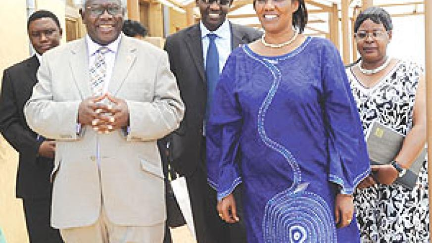CPA Secretary General Dr. William Shija (L) sharing a light moment with Speaker Rose Mukantabana at the parliamentary buildings yesterday. (Photo/ J. Mbanda)