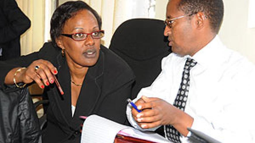 Ministry of Health's official  in charge of Mental Health, Yvonne Kayiteshonga chatting with CLNG's Deogene Bideri during a meeting on managing Trauma yesterday. (Photo; J. Mbanda).