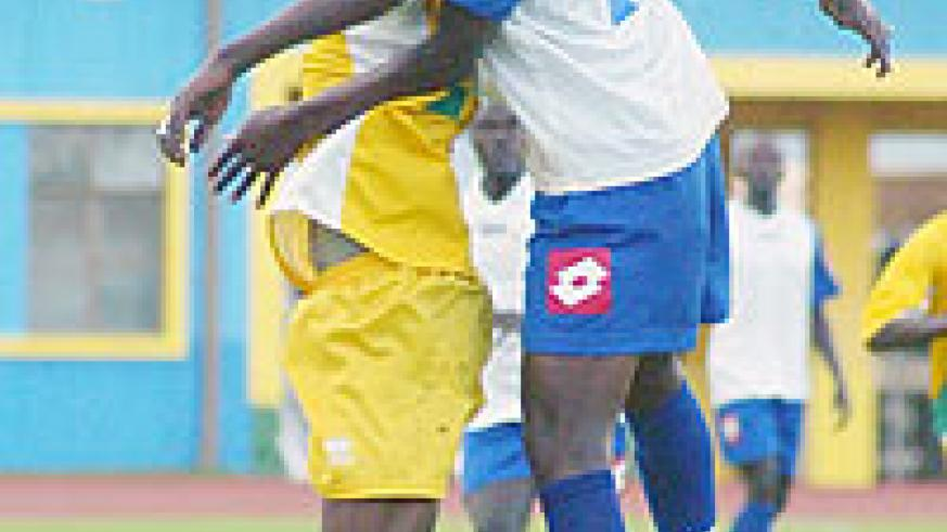 Atraco's André Lomami tries to head the ball during last year's league tie with Rayon Sport. The sides face off this afternoon. (File Photo)
