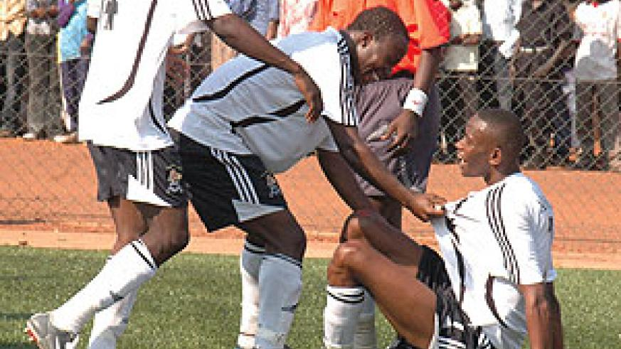 Migi (R) was the centre of contraversy for APR's winner against AS Kigali yesterday.