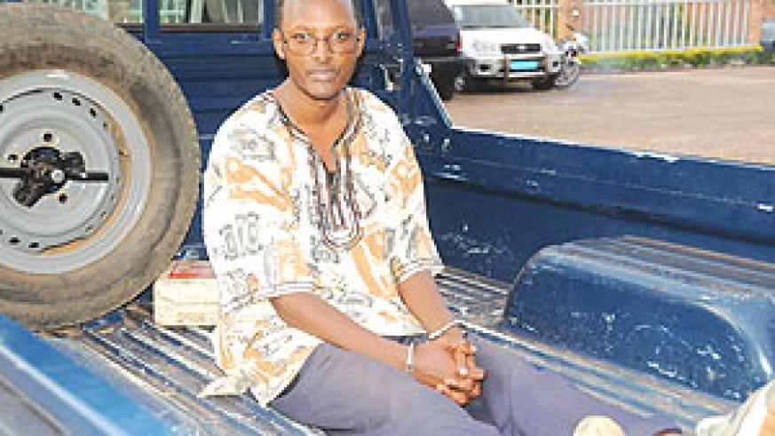 Deo Mushayidi in the back of a  Police Pick-up as he left prosecution headquarters in Kimihurura yesterday. (Photo/ J. Mbanda)