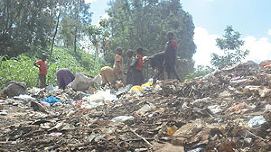TO BE PHASED OUT: Children going through the garbage heap at Nyanza Landfill