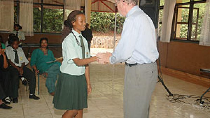 WELL DONE; Green Hills Headmaster shaking hands with one of the best students, Sarah Agatoni (Photo; F. Goodman)