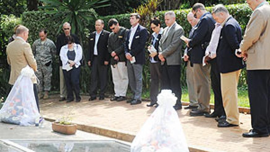 The US military delegation pay their respects after lying a wreath at Kigali Genocide Memorial centre yesterday. (Photo; J. Mbanda)