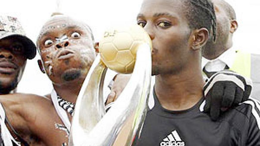 TP Mazembe skipper Tresor Mputu (R) kissing the 2009 African Champions League trophy. The phenomenon congolese player recently won the Glo-CAF local African player of the year award.