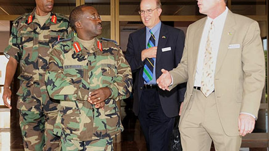 Chief of Defence Staff, Gen. James Kabarebe and the Chief of Air forces Lt. Gen.Charles Muhire with the Head of US military delegation, Gen.Robert Kane yesterday. (Photo J Mbanda)