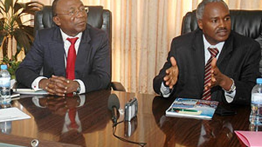 The Minister of Education Dr. Charles Murigande addressing the meeting yesterday as the AfDB Resident Representative Diko Jacob Mukete looks. (Photo; F. Goodman)