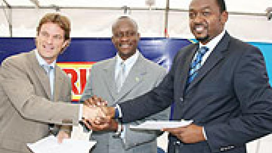 DEAL STRUCK; Joseph Habineza (C) graced the signing of the sponsorship deal signed by Bralirwa's MD, Sven Piederiet (L) and Ferwafa's Raoul Gisanura yesterday