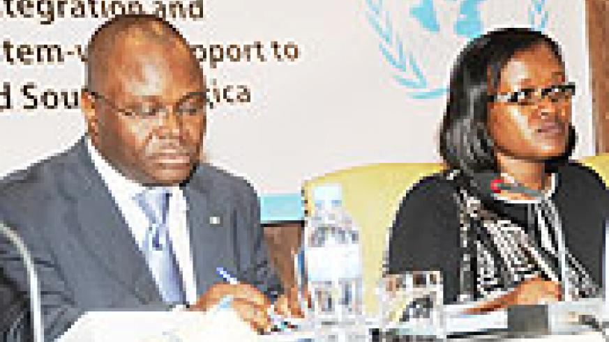 UN Country representative Aurelien Agbenonci (L) and Minister for East African Affairs Monique Mukaruliza at the High level meeting on Regional Integration. (Photo J. Mbanda)