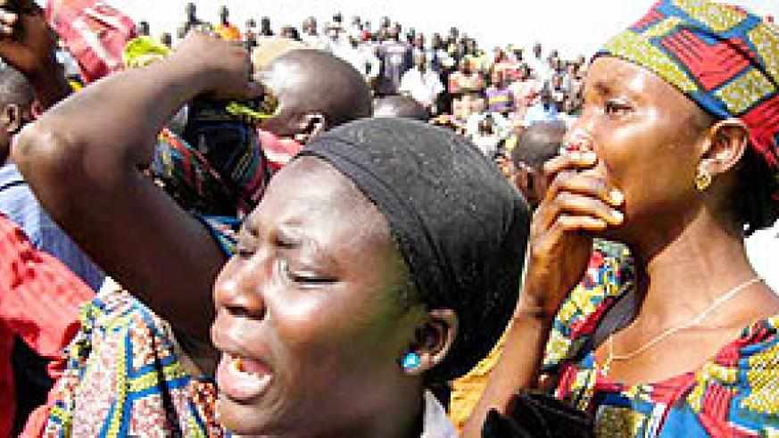 What goes on in Nigeria has impact in the region and Africa as a whole. Women mourn their lost relatives. (Net Photo)