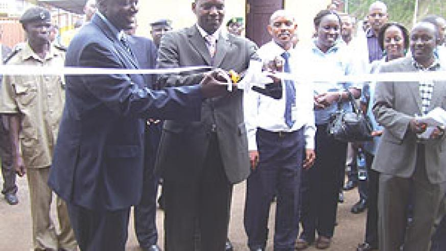 The PS in the Ministry of E.A.C Affairs, Robert Ssali flanked by Uganda's Ambassador to Rwanda, Richard Kabonero (L), at the launch of the one-stop border post (Photo/ A. Gahene)